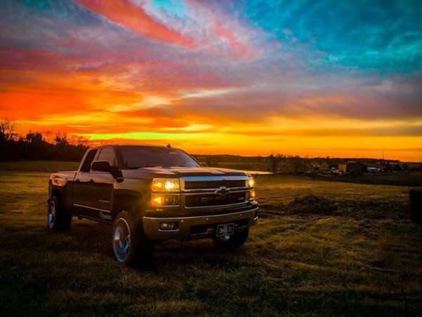 "2014 Chevy Silverado 1500 with MotoFab Lifts 3"" Front leveling lift kit"